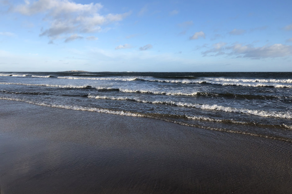 St Aidans beach looking towards the Farne Islands, Northumberland